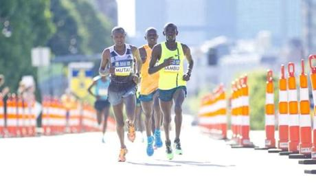 Stephen Sambu, Geoffrey Mutai, and Daniel Salel ran a tight race until Sambu started pulling away in the fifth mile to finish in 27 minutes, 25 seconds.